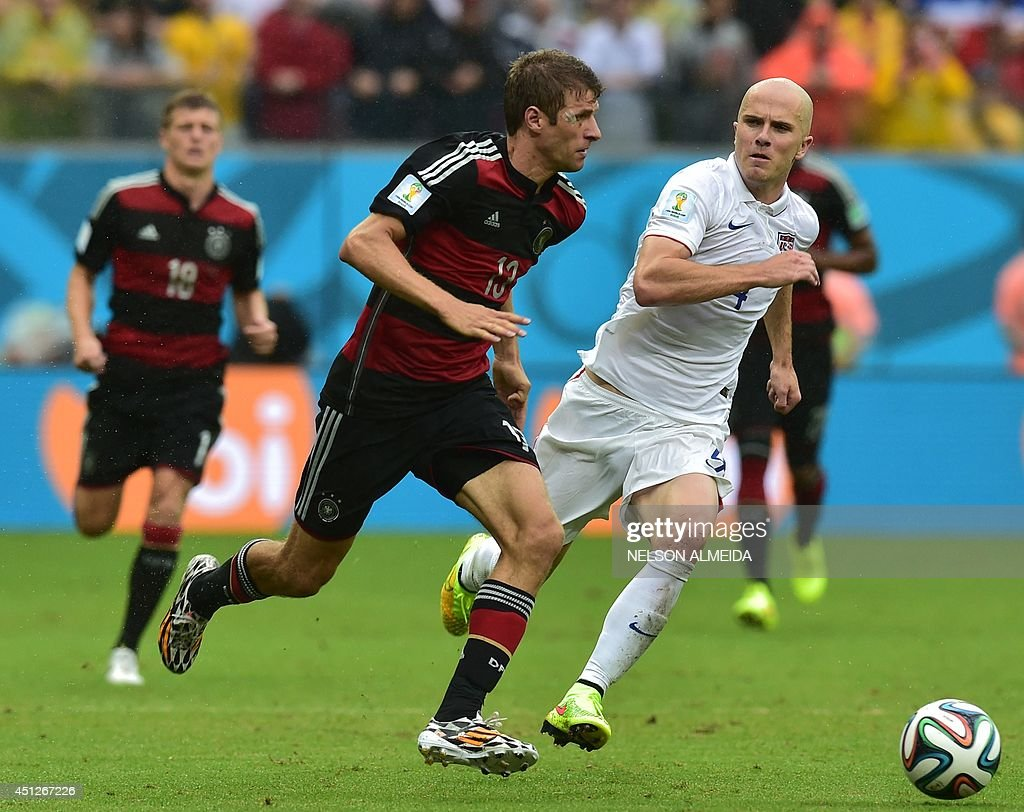 Germany's forward <a gi-track='captionPersonalityLinkClicked' href=/galleries/search?phrase=Thomas+Mueller&family=editorial&specificpeople=5842906 ng-click='$event.stopPropagation()'>Thomas Mueller</a> (L) and US midfielder <a gi-track='captionPersonalityLinkClicked' href=/galleries/search?phrase=Michael+Bradley+-+Soccer+Player&family=editorial&specificpeople=7022299 ng-click='$event.stopPropagation()'>Michael Bradley</a> vie for the ball during a Group G football match between US and Germany at the Pernambuco Arena in Recife during the 2014 FIFA World Cup on June 26, 2014.