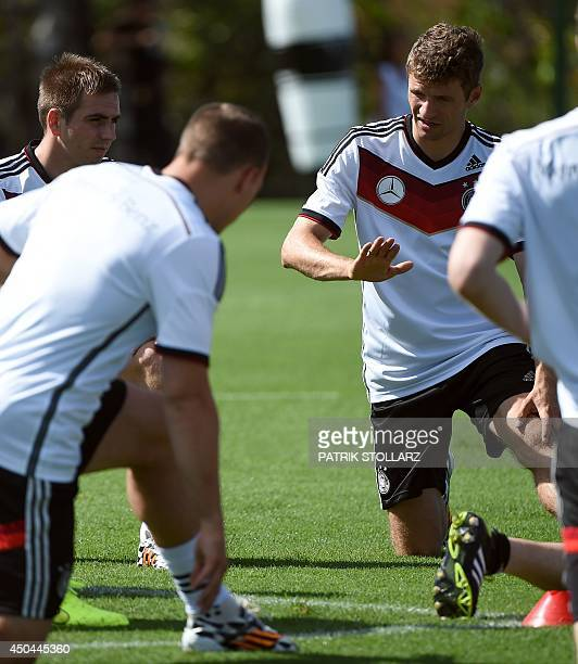 Germany's forward Thomas Mueller andGermany's midfielder Philipp Lahm strech during a training session of the Germany's national football team in...