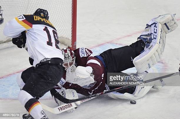 Germany's forward Thomas Oppenheimer scores past Latvia's goalie Kristers Gudlevskis during a preliminary round group B game Germay vs Latvia of the...