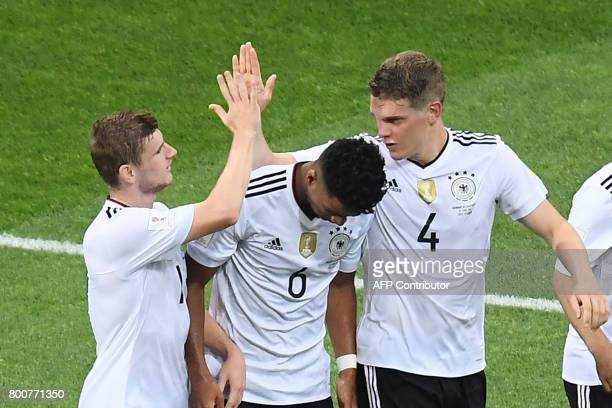 Germany's forward Timo Werner celebrates with Germany's defender Benjamin Henrichs and Germany's defender Matthias Ginter after scoring a goal during...