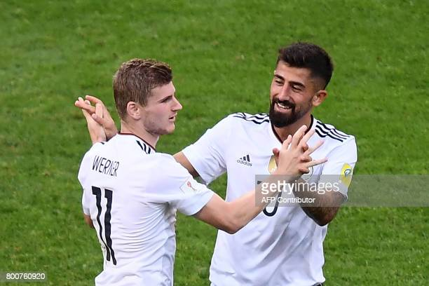 Germany's forward Timo Werner celebrates with Germany's midfielder Kerem Demirbay after scoring his team's second goal during the 2017 FIFA...