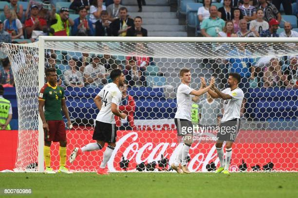 Germany's forward Timo Werner celebrates with Germany's midfielder Kerem Demirbay and Germany's midfielder Emre Can after scoring his team's second...