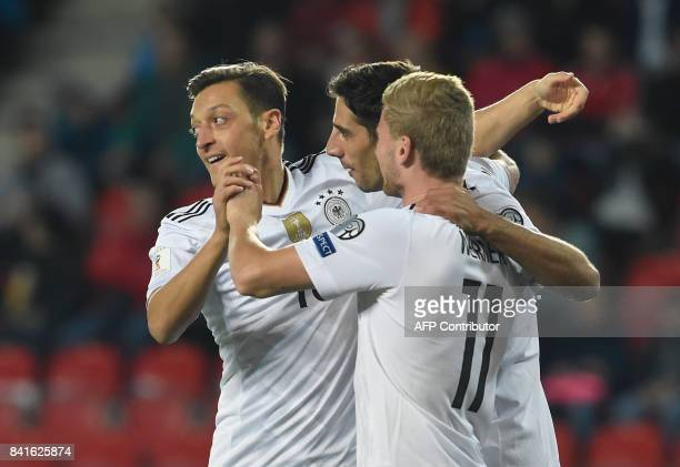 Germany's forward Timo Werner celebrates with Germany's midfielder Mesut Ozil and Germany's forward Lars Stindl scoring the opening goal during the...