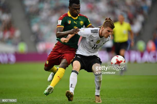 Germany's forward Timo Werner challenges Cameroon's defender Ernest Mabouka during the 2017 FIFA Confederations Cup group B football match between...