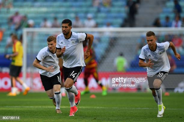 Germany's forward Timo Werner Germany's midfielder Emre Can and Germany's defender Joshua Kimmich warm up ahead of the 2017 FIFA Confederations Cup...
