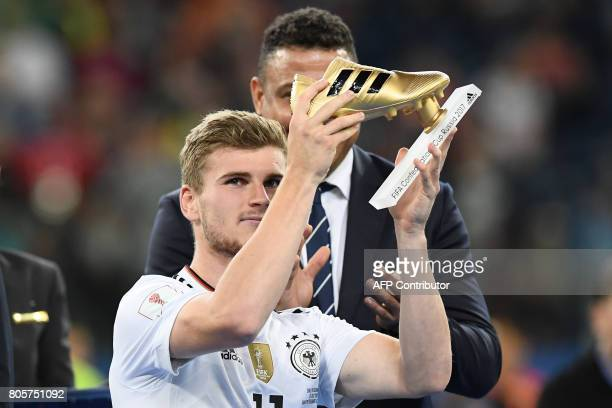 Germany's forward Timo Werner holds up the Golden Boot for best scorer after Germany beat Chile 10 in the 2017 Confederations Cup final football...