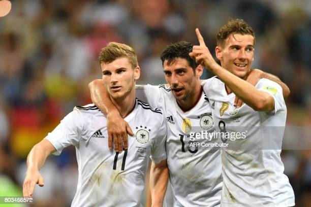 TOPSHOT Germany's forward Timo Werner L celebrate with Germany's midfielder Lars Stindl and Germany's midfielder Leon Goretzka after scoring during...