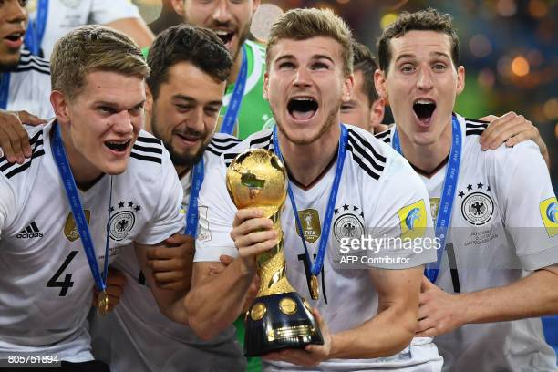 Germany's forward Timo Werner lifts the trophy after winning the 2017 Confederations Cup final football match between Chile and Germany at the Saint...