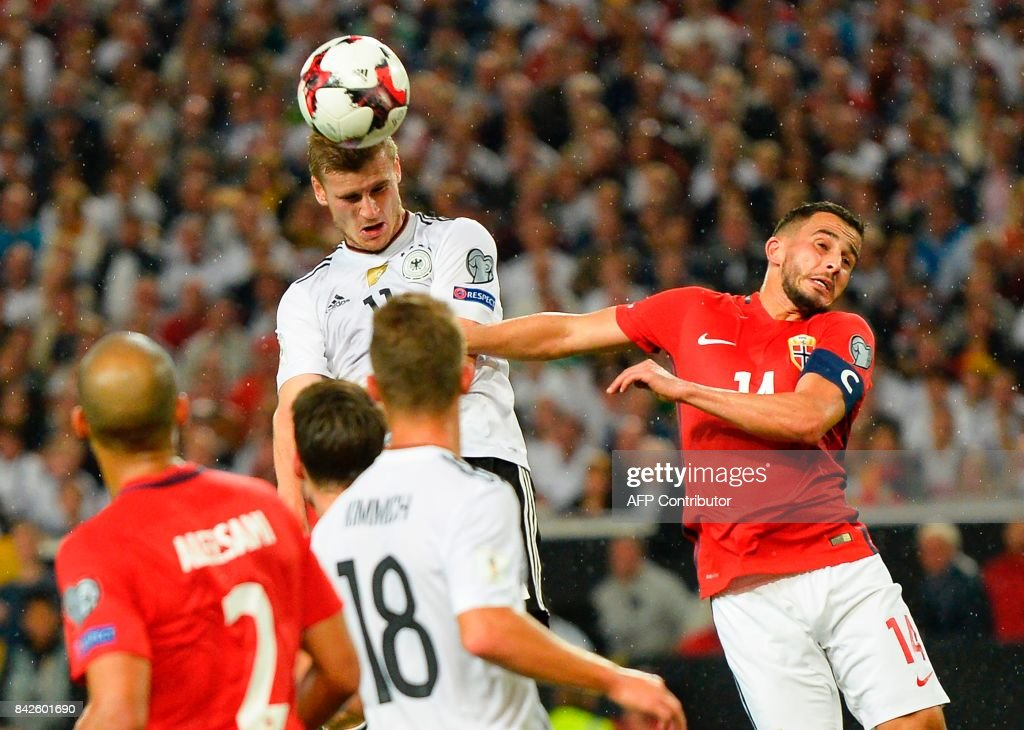Germany's forward Timo Werner (C) rise above the Norwegian defence to head in his side's fourth goal during the FIFA World Cup 2018 qualification match between Germany and Norway in the south German city of Stuttgart on September 4, 2017. /
