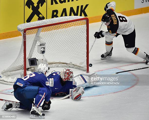 Germany's forward Tobias Rieder fails to score past France's goalie Cristobal Huet during the group B preliminary round game France vs Germany at the...