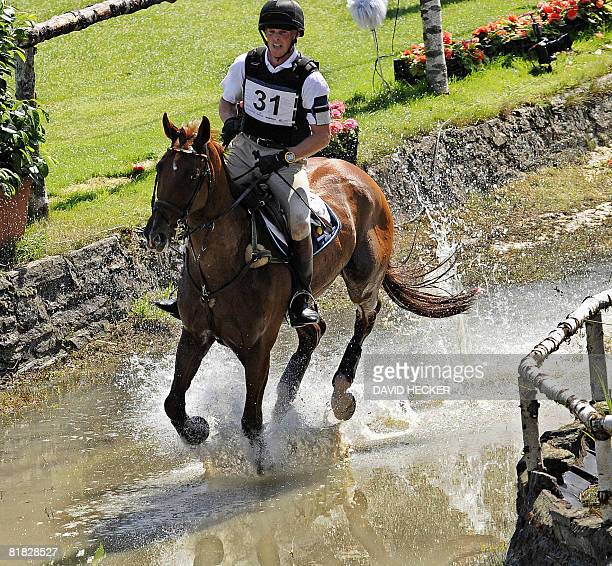 Germany's Frank Ostholt and his horse 'Air Jordan 2' ride through the water after a jump during the CHIO World Equestrian Festival in Aachen western...