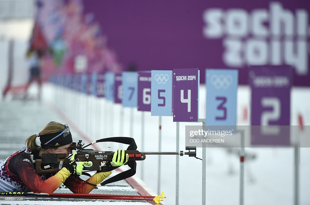 Germany's Franziska Hildebrand shoots at the range as she competes in the Women's Biathlon 15 km Individual at the Laura CrossCountry Ski and...