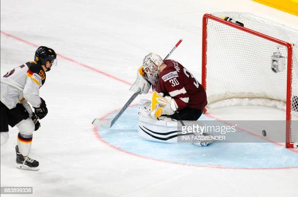 Germany's Fredrik Tiffels scores the winning penalty past Latvia's Elvis Merzlikins in the penalty shootout of the IIHF Men's World Championship Ice...