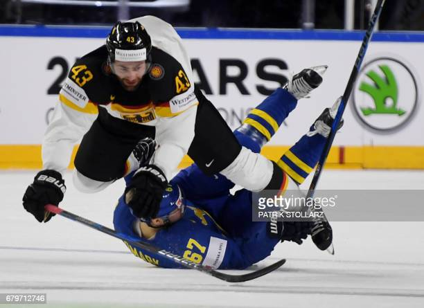 Germany´s Gerrit Fauser and Sweden´s Linus Omark vie for the puck during IIHF Icehockey world championship first round match between Sweden and...