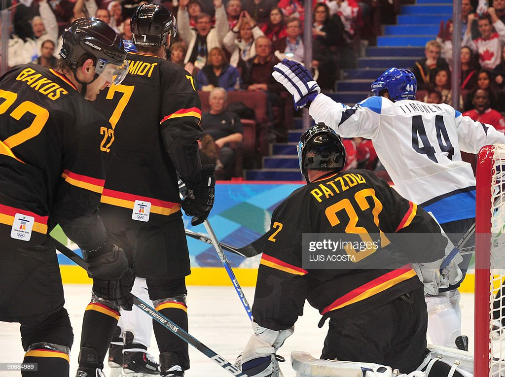 Germany's goal keeper Dimitri Patzold along with defender Christopher Schmidt and Michael Bakos defend their goal during the Men's preliminary Ice...
