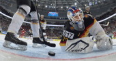 Germany's goalie Rob Zepp fails to block the puck during a IIHF International Ice Hockey World Championship preliminary round group B game between...