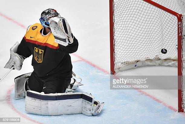 Germany's goalie Timo Pielmeier eyes the puck in his net during the group B preliminary round game Finland vs Germany at the 2016 IIHF Ice Hockey...