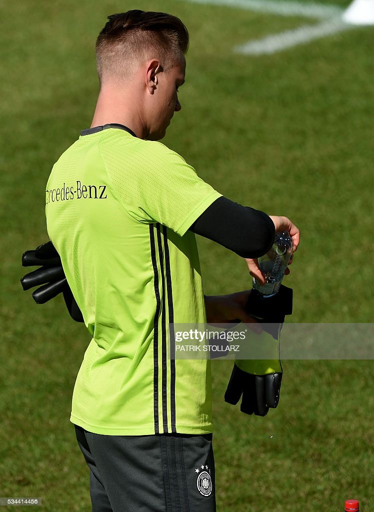 Germany's goalkeeper Andre TerStegen puts water into his gloves during a training session as part of the team's preparation for the upcoming Euro 2016 European football championships, on May 26, 2016 in Ascona. / AFP / PATRIK