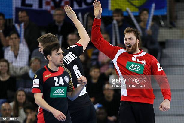 Germany's goalkeeper Andreas Wolff reacts with Germany's back Finn Lemke during the 25th IHF Men's World Championship 2017 Group C handball match...