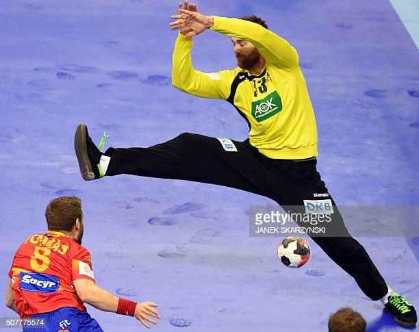Germany's goalkeeper Andreas Wolff vies with Spain's Victor Tomas during the final match of the Men's 2016 EHF European Handball Championship between...