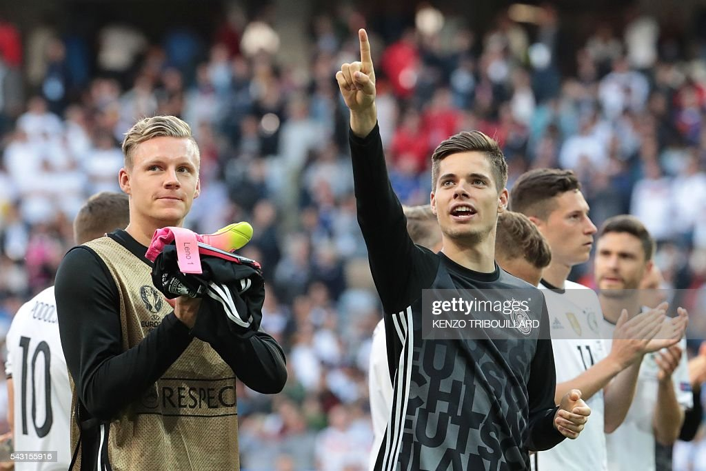 Germany's goalkeeper Bernd Leno and Germany's midfielder Julian Weigl (R) celebrate with teammates at the end of the Euro 2016 round of 16 football match between Germany and Slovakia at the Pierre-Mauroy stadium in Villeneuve-d'Ascq near Lille on June 26, 2016. / AFP / KENZO