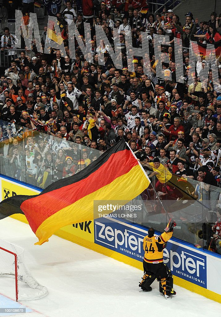 Germany's goalkeeper Dennis Endras waves a giant German flag as he celebrates with fans after the IIHF Ice Hockey World Championship quarter-final match Switzerland vs Germany in the southern German city of Mannheim on May 20, 2010. The 2010 IIHF Ice Hockey World Championships are taking place in Germany from May 7 to 23, 2010. Germany won the match 0-1.