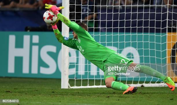 Germany's goalkeeper Julian Pollersbeck saves the last penalty in penalty shooting during the UEFA U21 European Championship football semi final...