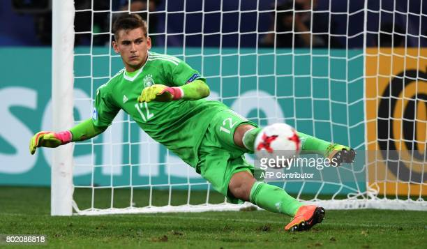 Germany's goalkeeper Julian Pollersbeck tries to make a save during penalty shooting during the UEFA U21 European Championship football semi final...