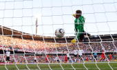 Germany's goalkeeper Manuel Neuer eyes the ball shot by England player Frank Lampard before the goal was disallowed during the 2010 World Cup round...