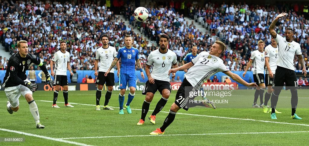 Germany's goalkeeper Manuel Neuer, Germany's midfielder Sami Khedira and Germany's midfielder Joshua Kimmich eye the ball during the Euro 2016 round of 16 football match between Germany and Slovakia at the Pierre-Mauroy stadium in Villeneuve-d'Ascq, near Lille, on June 26, 2016. / AFP / PHILIPPE