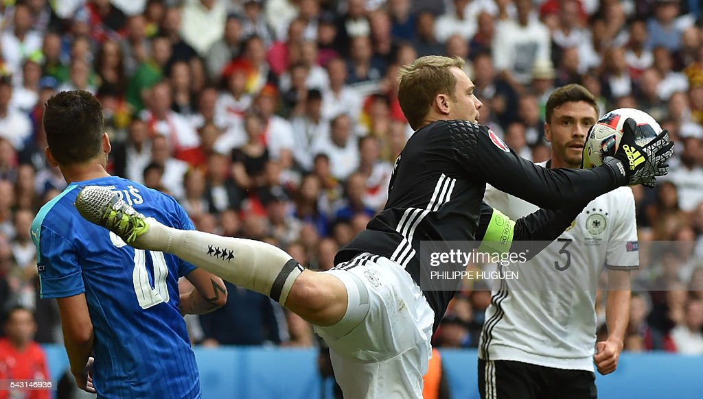 Germany's goalkeeper Manuel Neuer jumps for the ball during the Euro 2016 round of 16 football match between Germany and Slovakia at the Pierre-Mauroy stadium in Villeneuve-d'Ascq, near Lille, on June 26, 2016. / AFP / PHILIPPE