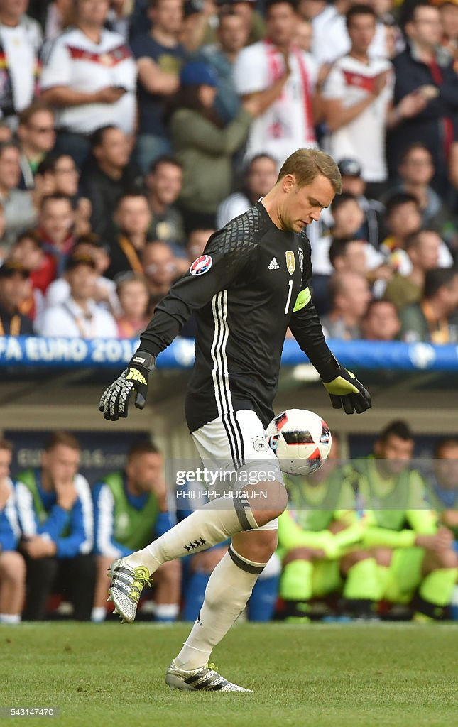 Germany's goalkeeper Manuel Neuer kicks the ball during the Euro 2016 round of 16 football match between Germany and Slovakia at the Pierre-Mauroy stadium in Villeneuve-d'Ascq, near Lille, on June 26, 2016. / AFP / PHILIPPE