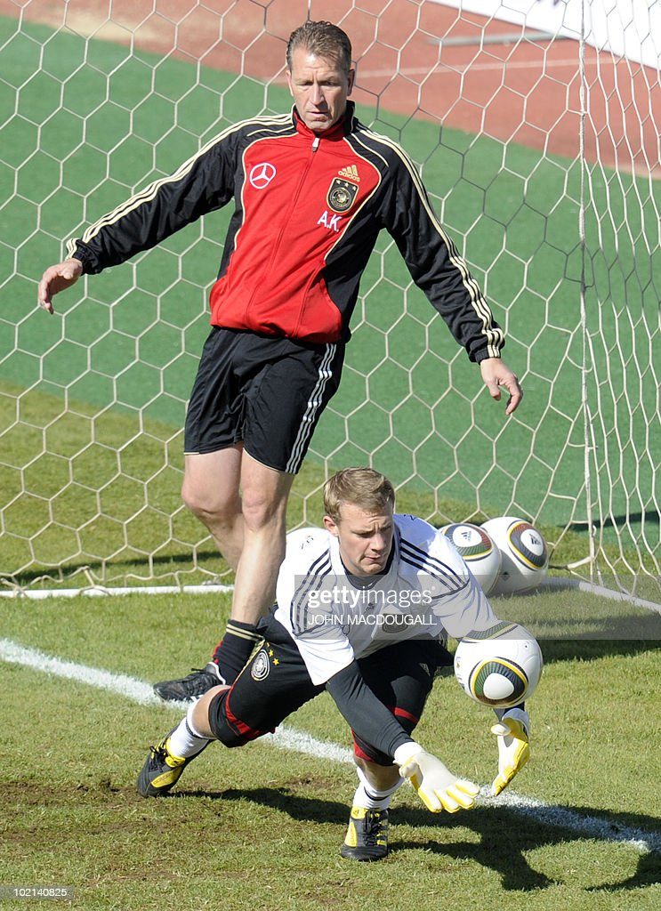 Germany's goalkeeper Manuel Neuer (bottom) makes a save as German goalkeeper trainer Andreas Koepke looks on during a training session at the Super stadium in Atteridgeville near Pretoria June 16, 2010.