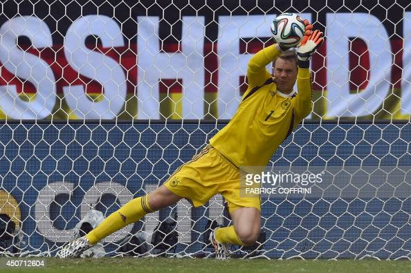 Germany's goalkeeper Manuel Neuer makes a save during the Group G football match between Germany and Portugal at the Fonte Nova Arena in Salvador on...
