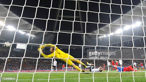 Germany's goalkeeper Manuel Neuer reaches for a shot on goal that goes wide during the 2010 World Cup semifinal football match between Germany and...