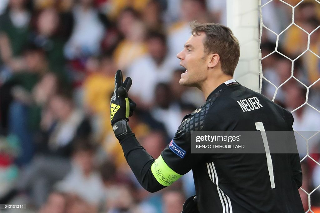 Germany's goalkeeper Manuel Neuer reacts during the Euro 2016 round of 16 football match between Germany and Slovakia at the Pierre-Mauroy stadium in Villeneuve-d'Ascq near Lille on June 26, 2016. / AFP / KENZO