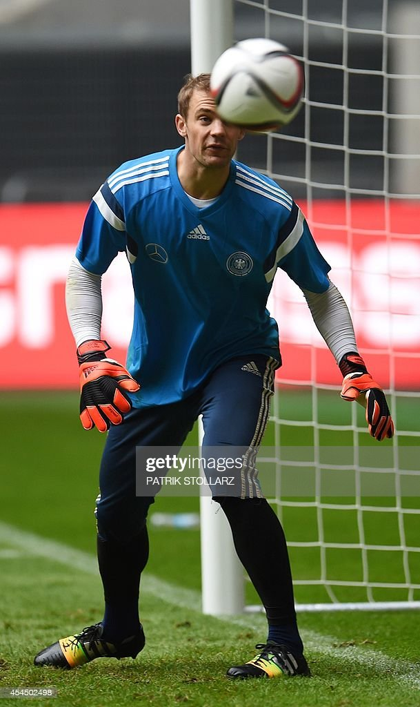 Germany's goalkeeper Manuel Neuer warms up during a training session of the German national football team in Duesseldorf, western Germany on September 2, 2014. Germany's squad prepares for the upcoming friendly game against Argentina on September 3, 2014 in Duesseldorf. AFP PHOTO / PATRIK STOLLARZ