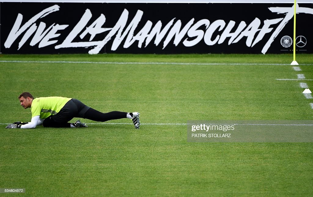 Germany's goalkeeper Manuel Neuer warms up during a training session as part of the team's preparation for the upcoming Euro 2016 European football championships, on May 28, 2016 in Ascona. / AFP / PATRIK