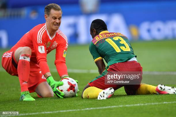 Germany's goalkeeper MarcAndre Ter Stegen blocks a shot on goal by Cameroon's forward Christian Bassogog during the 2017 FIFA Confederations Cup...