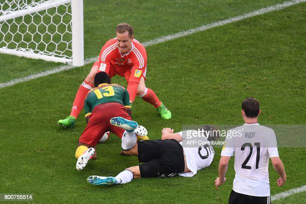 Germany's goalkeeper MarcAndre Ter Stegen grabs the ball as Cameroon's forward Christian Bassogog advances to score during the 2017 FIFA...