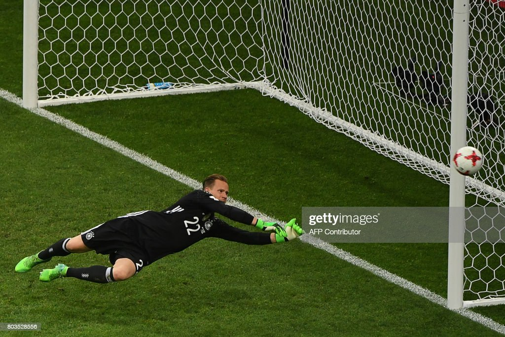 Germany's goalkeeper Marc-Andre Ter Stegen punches the ball away during the 2017 Confederations Cup semi-final football match between Germany and Mexico at the Fisht Stadium in Sochi on June 29, 2017. / AFP PHOTO / Patrik STOLLARZ