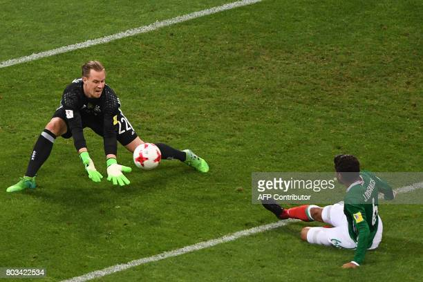 Germany's goalkeeper MarcAndre Ter Stegen stops a shot on goal by Mexico's midfielder Jonathan Dos Santos during the 2017 FIFA Confederations Cup...