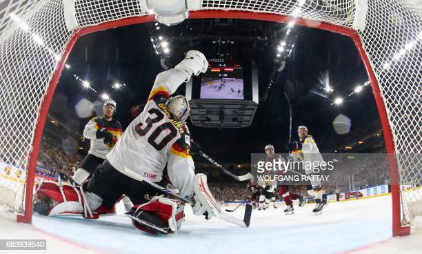 Germany's goalkeeper Philipp Grubauer makes a save during the IIHF Men's World Championship Ice Hockey match between Germany and Latvia in Cologne...