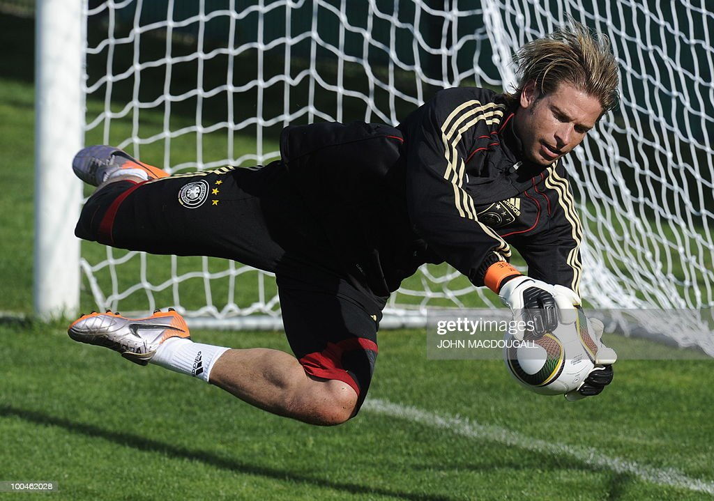 Germany's goalkeeper Tim Wiese goes for a save during the warm up session prior to a training match Germany vs Sued Tyrol FC at the team's training centre in Appiano, near the north Italian city of Bolzano May 24, 2010. The German football team is currently taking part in a 12-day training camp in Appiano to prepare for the upcoming FIFA Football World Cup in South Africa.