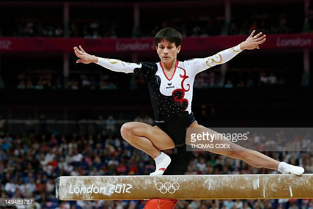 Germany's gymnast Oksana Chusovitina performs on the beam during the women's qualification of the artistic gymnastics event of the London Olympic...