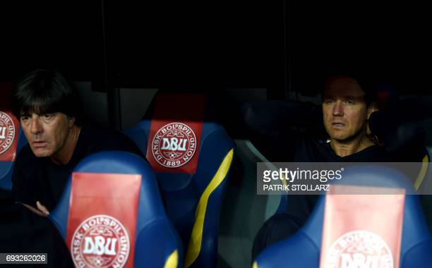 Germany's head coach Joachim Loew and Germany's assistance coach Marcus Sorg look on prior to the friendly football match of Denmark vs Germany in...
