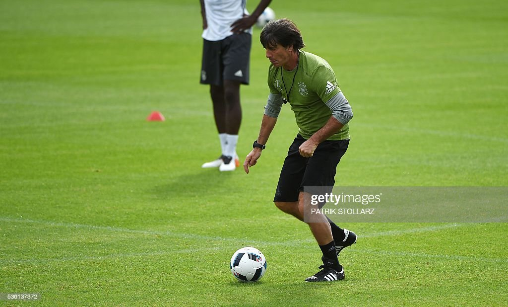 Germany's head coach Joachim Loew controls the ball during a training session on May 31, 2016 in Ascona as part of the team's preparation for the upcoming Euro 2016 European football championships. / AFP / PATRIK