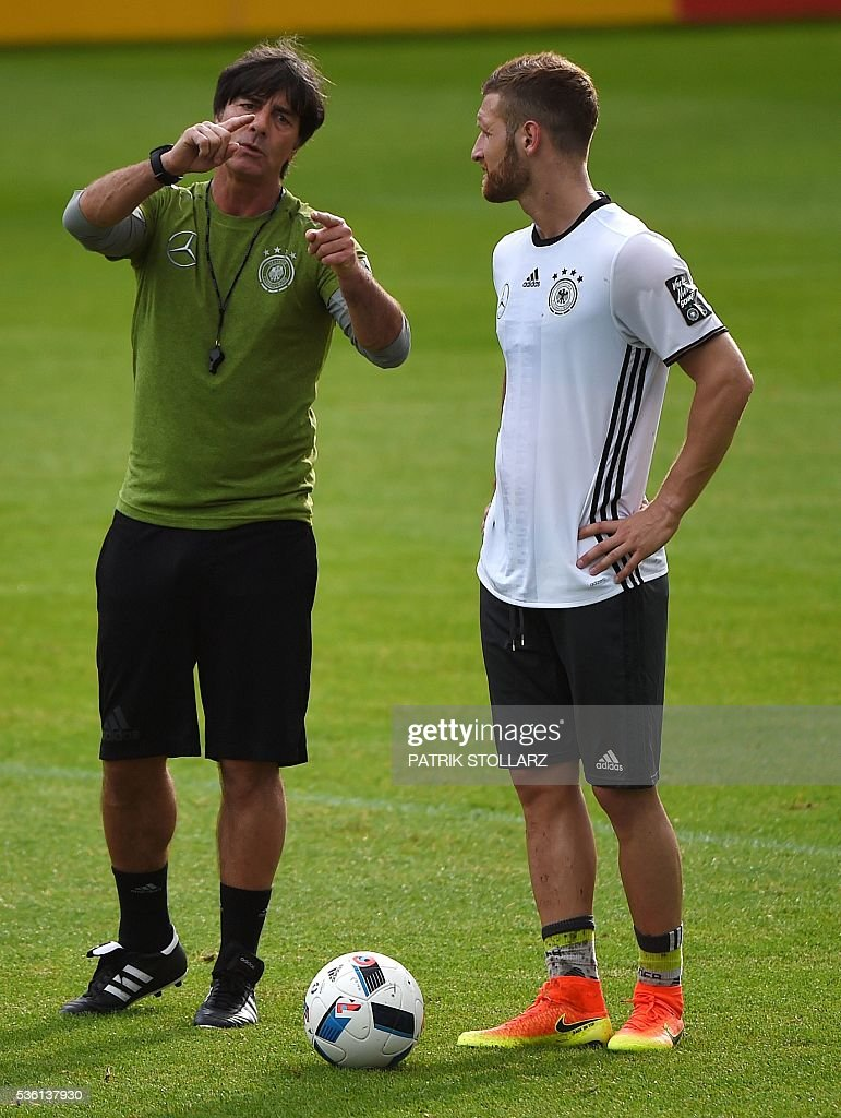 Germany's head coach Joachim Loew (L) gestures as Germany's midfielder Skodran Mustafi looks on during a training session on May 31, 2016 in Ascona as part of the team's preparation for the upcoming Euro 2016 European football championships. / AFP / PATRIK