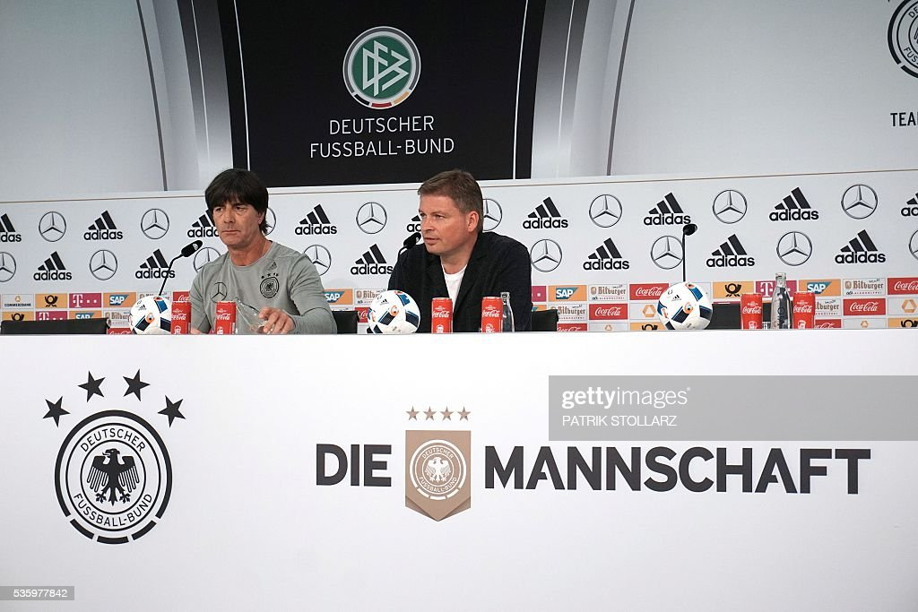 Germany's head coach Joachim Loew (L) is pictured as he gives a press conference on the sideline of the team's preparation for the upcoming Euro 2016 European football championships, on May 31, 2016 in Ascona. / AFP / PATRIK