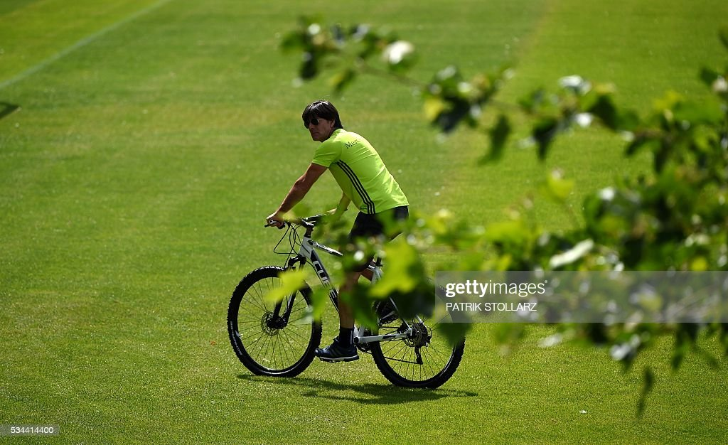 Germany's head coach Joachim Loew leaves on a bike from a training session as part of the team's preparation for the upcoming Euro 2016 European football championships, on May 26, 2016 in Ascona. / AFP / PATRIK